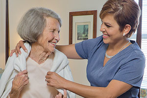 Skilled nurse assisting Brethren Village resident