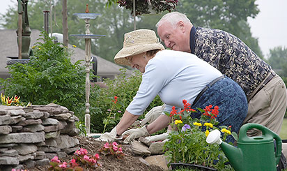Residents planting a garden on their property